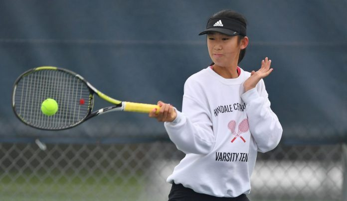 Hinsdale Central's Nicole Hu happy to be back playing tennis with her high school teammates because 'I love them so much.'