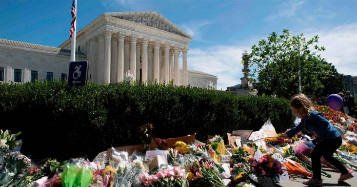 Watch: Ginsburg mourners build flower memorial outside Supreme Court